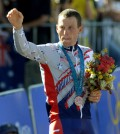 US Lance Armstrong celebrates on the podium after