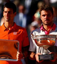 Novak Djokovic & Stan Wawrinka pose with their trophies after the final of Rolland Garros (French Open) 2015