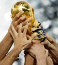 Italy players hold aloft the FIFA World Cup trophy.