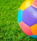 real-leather-colorful-multi-colour-soccer-ball-on-green-grass_1232-3048